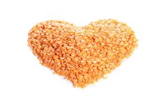 Lentil into your heart. Red lentils made into a heart shape Stock Images