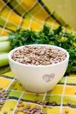 lentilhas em uma placa branca Foto de Stock Royalty Free