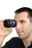 lentille belle regardant des jeunes d'homme Images stock