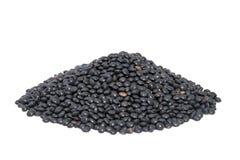Lentilles noires de beluga de pile d'isolement sur le blanc. Photographie stock libre de droits