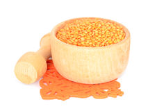 Lentils in a bowl. Lentils in a wooden bowl isolated on white Royalty Free Stock Photos