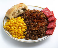 Lentils with canned corn. Dish with lentils and corn isolared on white Stock Image