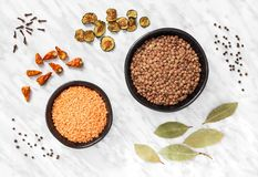 Lentils and cooking ingredients on marble background stock image