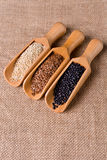 Lentils, flax and quinoa seeds in wooden spoon. Stock Photo