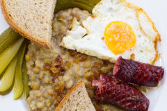 Lentils with sausage and egg Royalty Free Stock Images