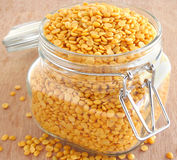 Lentils. In a glass jar on a wooden background Stock Photo