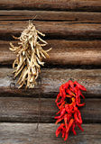 Lentils and hot peppers. Outside of the house wall farmers drying dried vegetable royalty free stock photo