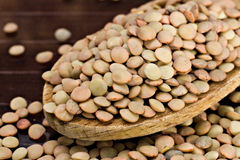 Lentils - Lens culinaris. Closeup of Lentils over a wooden spoon Royalty Free Stock Photos