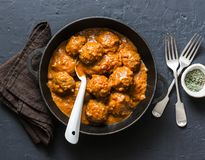 Lentils meatballs in curry sauce in cooking pan - vegetarian food in Indian style. Healthy eating concept. Top view stock photo
