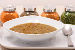 Lentils plate. Surrounded with container legumes Stock Photo