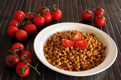 Lentils and red cherry tomatoes Stock Photography