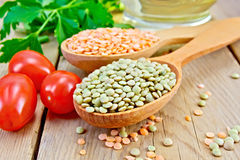 Lentils red and green with tomato on board Royalty Free Stock Photography