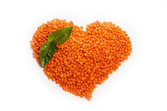 Lentils in the shape of a Heart with basil isolated on white ba. Ckground stock image