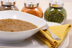 Lentils soup. Lentils plate with legume containers on background royalty free stock photo