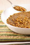 Lentils soup. Delicious fresh lentil soup and silver spoon royalty free stock photo