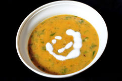Pumpkin Lentils soup with cream garnishing Royalty Free Stock Photography