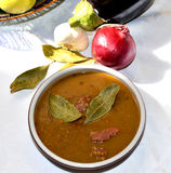 Lentils soup. Table with lentils soup and vegetables royalty free stock photography