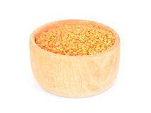 Lentils in a wooden bowl. Lentils in a bowl isolated on white Stock Image
