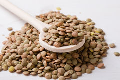 Lentils with wooden spoon Stock Photo