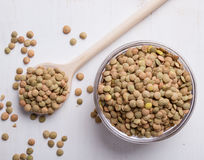 Lentils with wooden spoon Royalty Free Stock Photos
