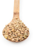 Lentils with wooden spoon Royalty Free Stock Photo