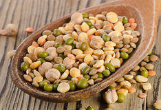 Lentils on  wooden table Stock Photography