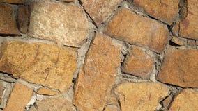 Lento gire o close-up da parede de pedra do movimento Lentamente close up movente 4k da alvenaria da rotação video estoque