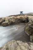 Leo Carrillo Beach Lifeguard Tower Malibu. Rocky cove with motion blur water below lifeguard tower at Leo Carrillo State Beach in Malibu, California Stock Image