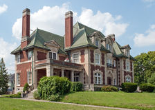 Leo Flesh Mansion. Is an historic example of Chateauesque style architecture and  is constructed of brick and stone with a steep hipped slate roof.  It has a Royalty Free Stock Photo