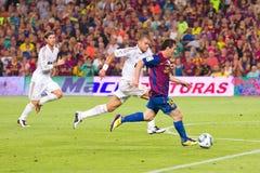Leo Messi e Pepe nell'azione Immagine Stock