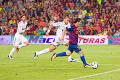 Leo Messi and Pepe in action Stock Image