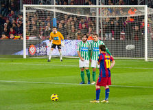 Leo Messi shooting a free kick. BARCELONA - JANUARY 12: Leo Messi in action during the match between FC Barcelona and Real Betis, final score 5-0, on January 12 royalty free stock images