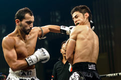 Leo Pinto of France and Mourad Harfaoui of Morocco in Thai Fight 2013. Royalty Free Stock Photography