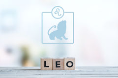 Leo star sign on a table. Leo star sign on a wooden table royalty free stock photo