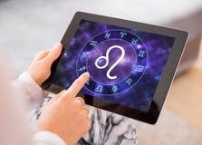 Leo zodiac sign. On tablet stock photos