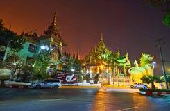 The leogryphs at the Shwedagon North Gate, Yangon, Myanmar. YANGON, MYANMAR - FEBRUARY 27, 2018: The great statues of chinthe leogryphs at the North Gate of stock photos