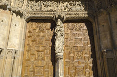 Leon cathedral. Doorway, detail of the gate and stone sculptures Stock Photos