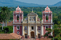 Leon city cathedral. Exterior view of Leon city cathedral with scenic forest in background, Leon city, Nicaragua royalty free stock photography