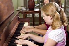 Leçon de piano Photo stock