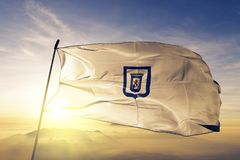 Leon Department of Nicaragua flag textile cloth fabric waving on the top sunrise mist fog. Beautiful royalty free stock photo