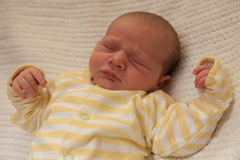 Leon Sleeping. View of a baby lying on a bed asleep Royalty Free Stock Photos