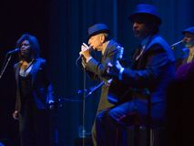 Leonard Cohen performs on stage at Sportarena Stock Photos