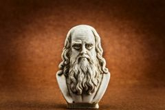 Leonardo da vinci brown background. Leonardo da vinci statue, one of the greatest mind in the humanity, on brown background stock images