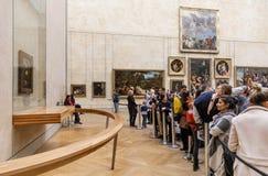Leonardo Da Vinci`s Mona Lisa at the Louvre Museumn. PARIS, FRANCE - Nov 10, 2017: Visitors do selfie and take photo of Leonardo Da Vinci`s Mona Lisa at the Stock Images