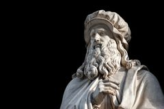 Leonardo Da Vinci statue on black background. Leonardo Da Vinci statue, by Luigi Pampaloni, 1839. It is located in the Uffizi courtyard, in Florence royalty free stock photos