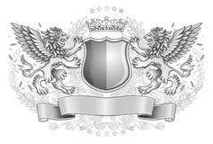 Leones cons alas que sostienen el emblema del escudo Imagen de archivo libre de regalías