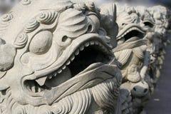 Leoni di pietra asiatici fotografia stock libera da diritti