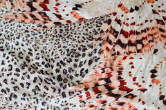 Leopard and bird feathers. Leopard fabric pattern,silk fabric Stock Photography