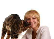 The leopard cat and girl. The leopard cat (Prionailurus bengalensis) and girl on a white background Stock Photos