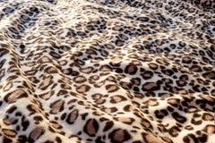 Leopard cat pattern blanket background print. Fur stock photos